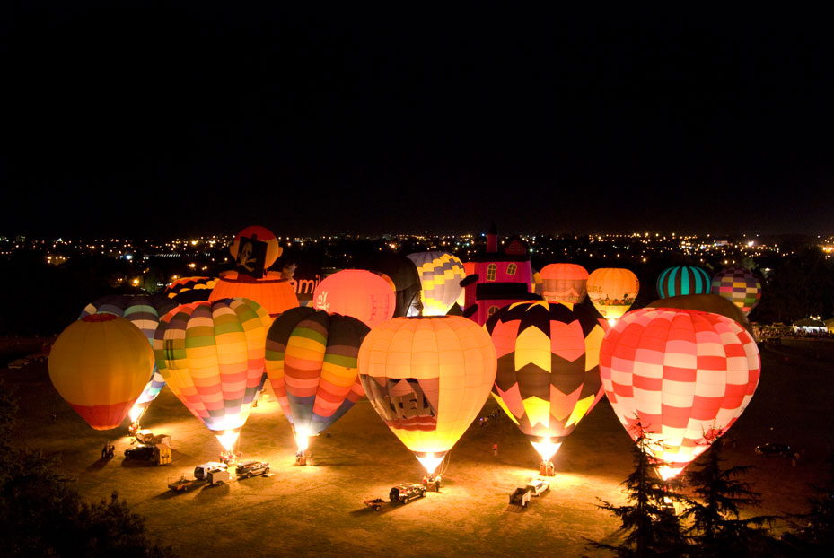 Aerial view of lighted up tethered balloons at Ballons over Waikato, New Zealand