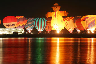 Lighted up ballons at night reflecting into the lake, Hamilton, New Zealand