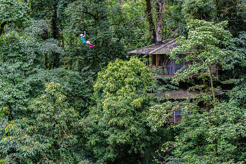 Girl ziplining through treetops in Costa Rica