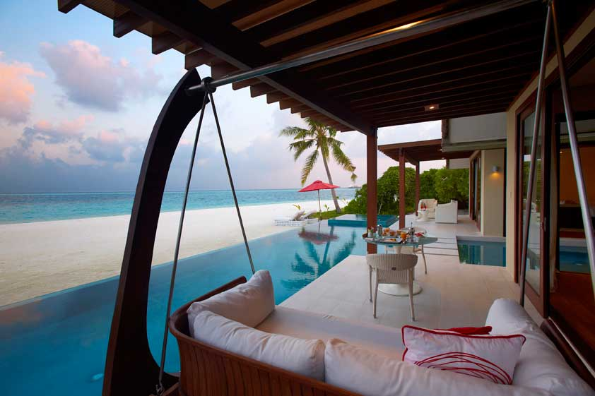 View of a swing onto an infinity pool and beach and ocean in the distance, Niyama, Maldives