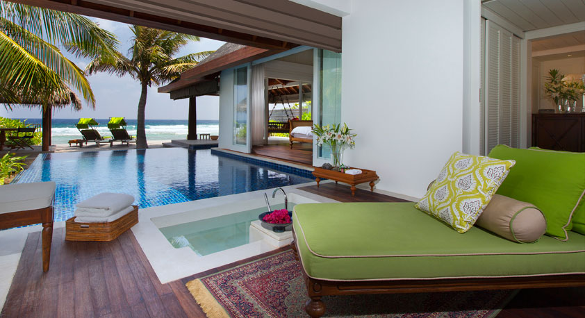 A view through several rooms of a suite to the ocean, Naladhu, Maldives