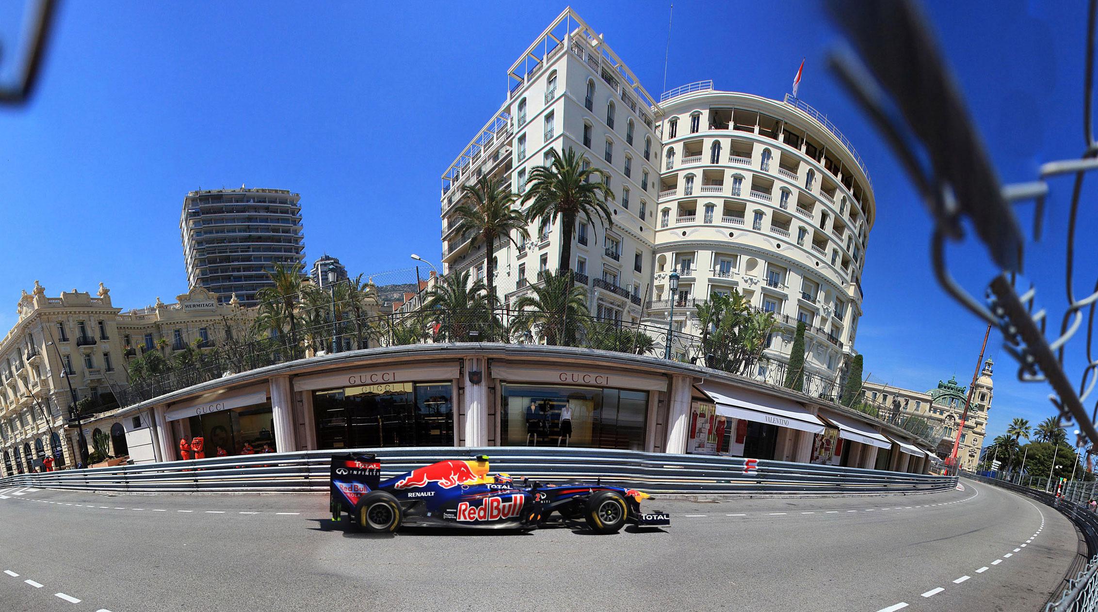 A Formula 1 car racing in an empty street in Monaco
