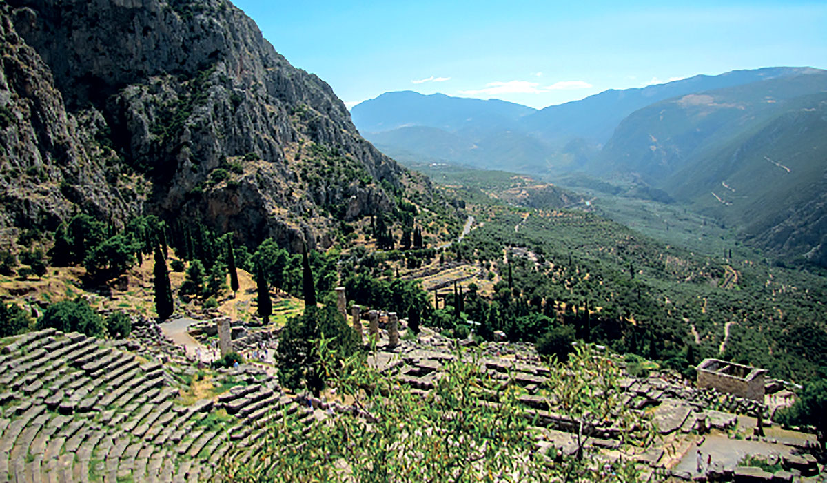 View down past steps and ruins into a valley at Delphi, Greece