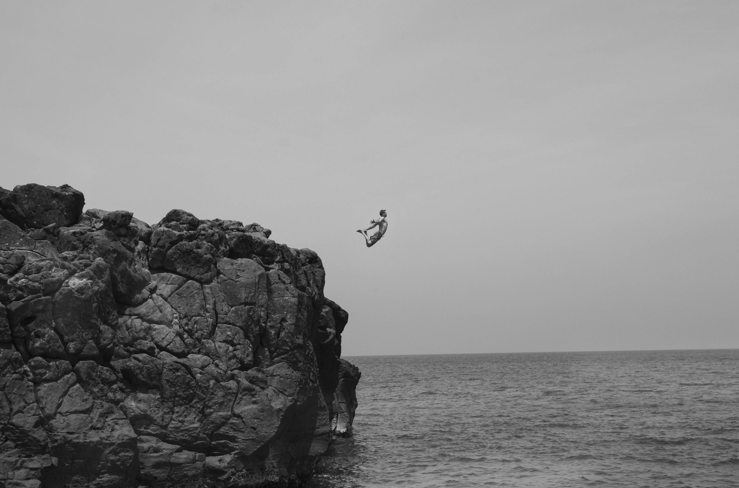 Thai Neave, travel photographer, jumps off a rock