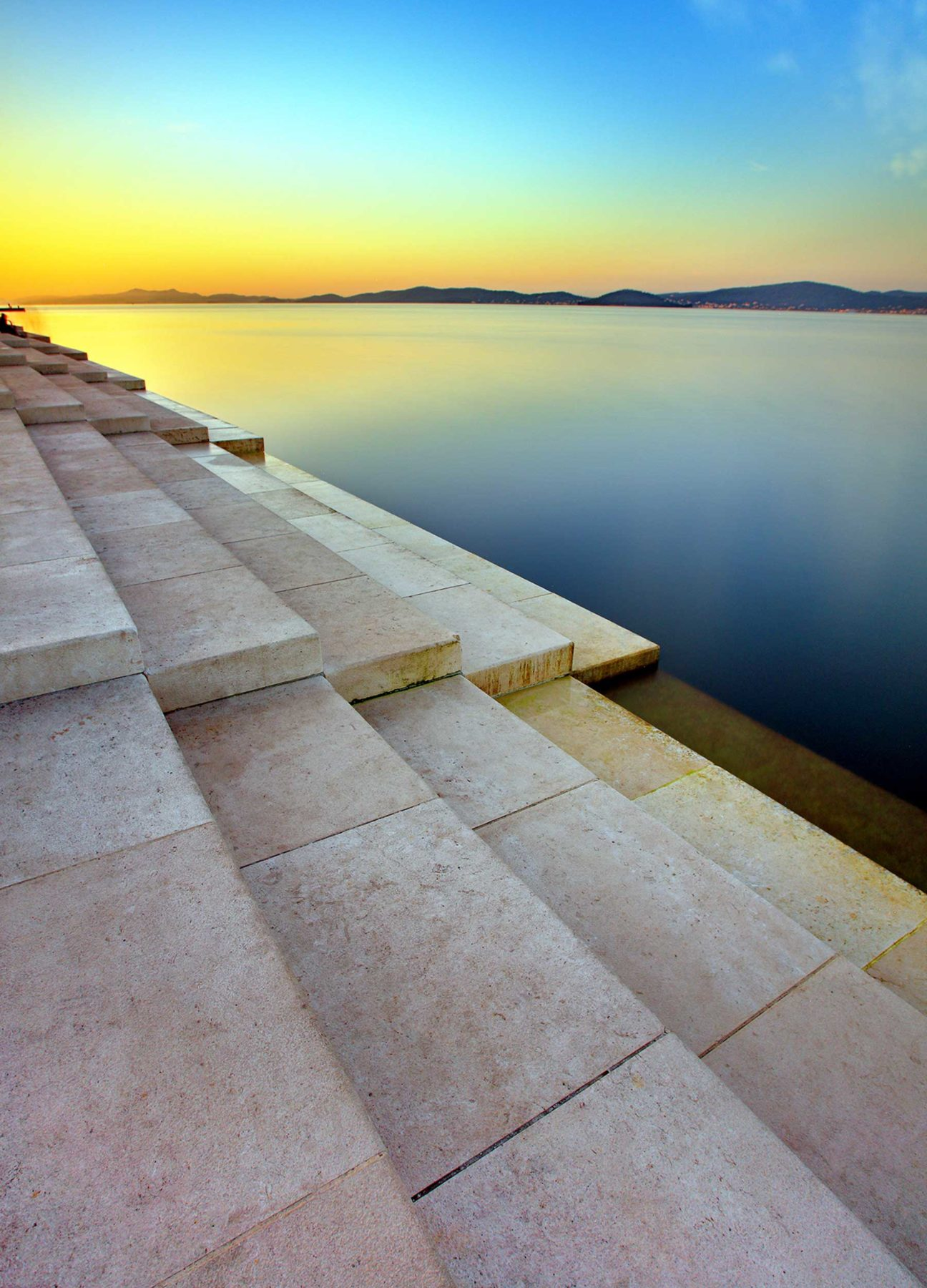 A series of steps leading into the sea, the Sea Organ exhibit, Croatia.