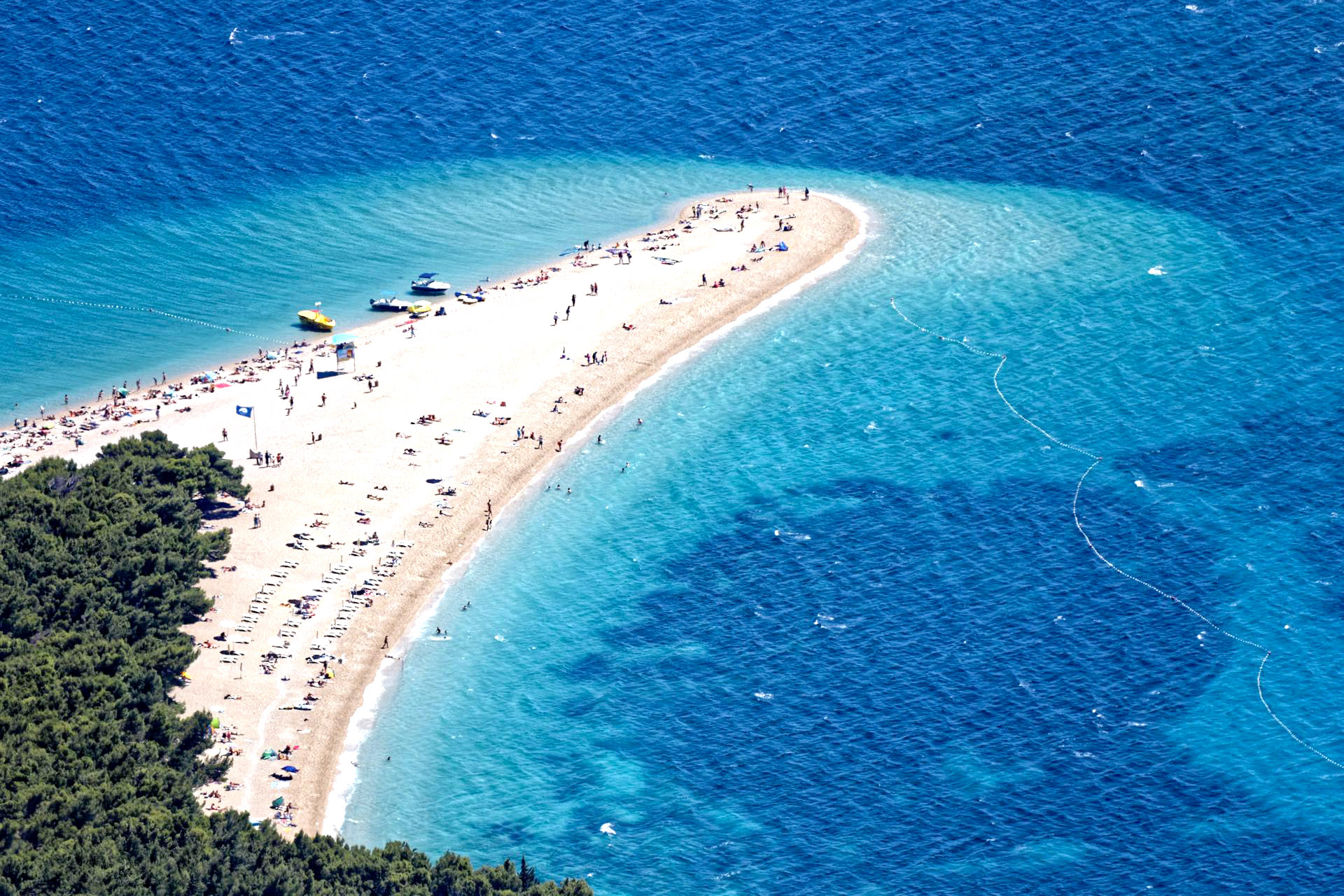 Aerial view of a large sandspit extending out into the ocean, Zlatni Rat Beach, Croatia.