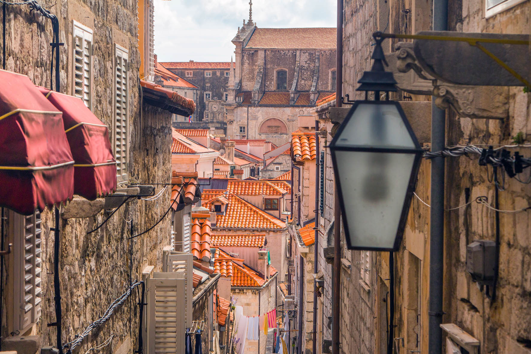Looking through the narrow gap between the town's buildings at orange-tiled roofs in Old Town, Dubrovnik.