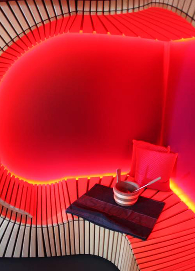 A curved red, wooden slatted sitting area