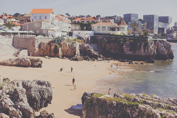 View of the beach, rocks and Cascais town buildings in Portugal