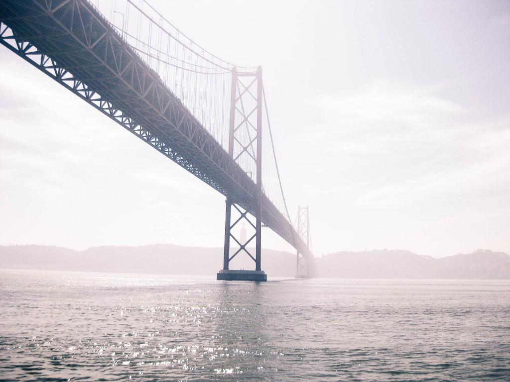 A suspension bridge over water, 25 de Abril Bridge in Lisbon over Tagus River.