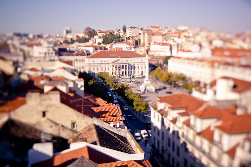 Aerial view of Lisbon city and looking into a square surrounded by the town's buildings.
