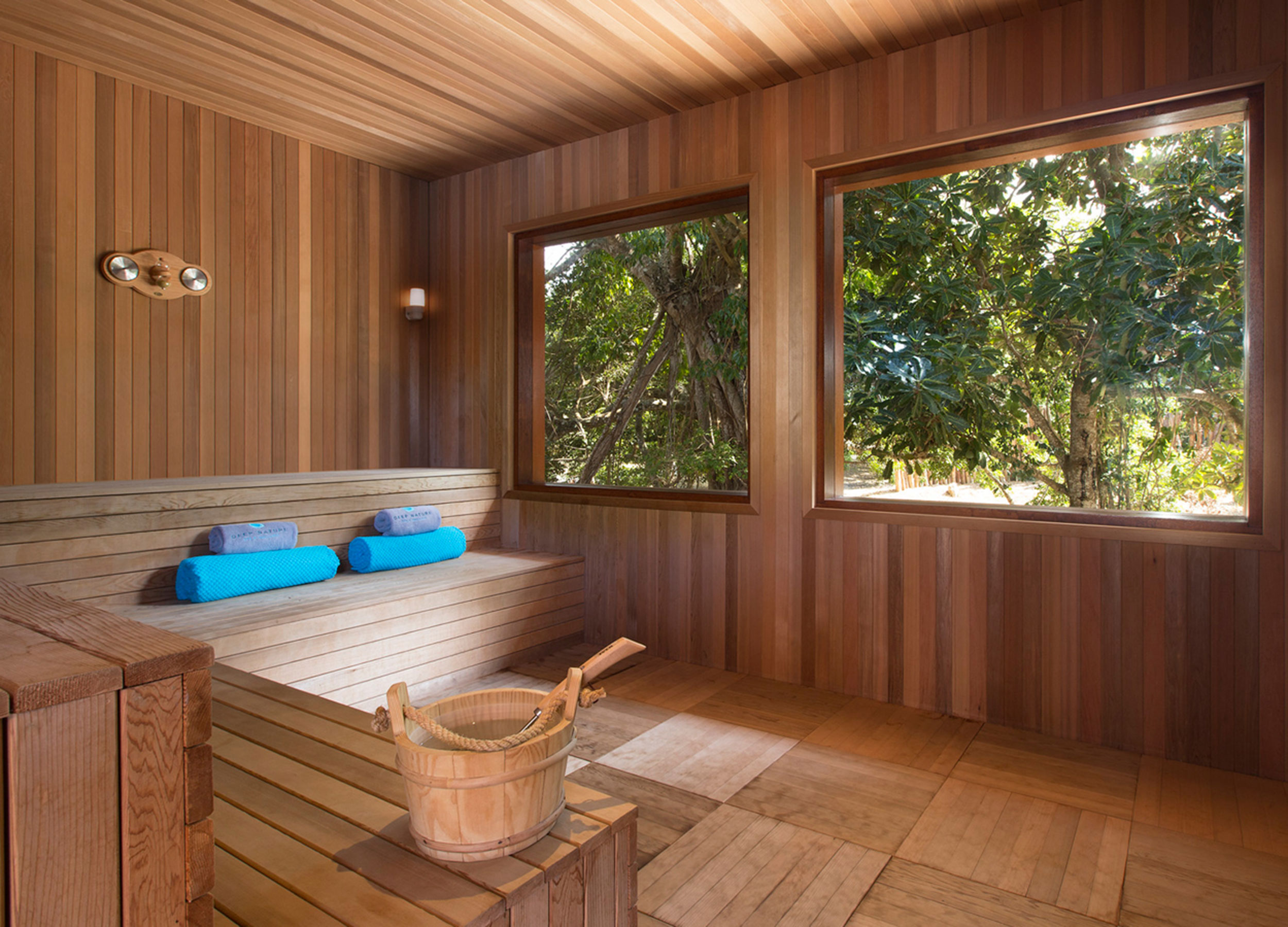 View into a sauna room overlooking trees outside its windows