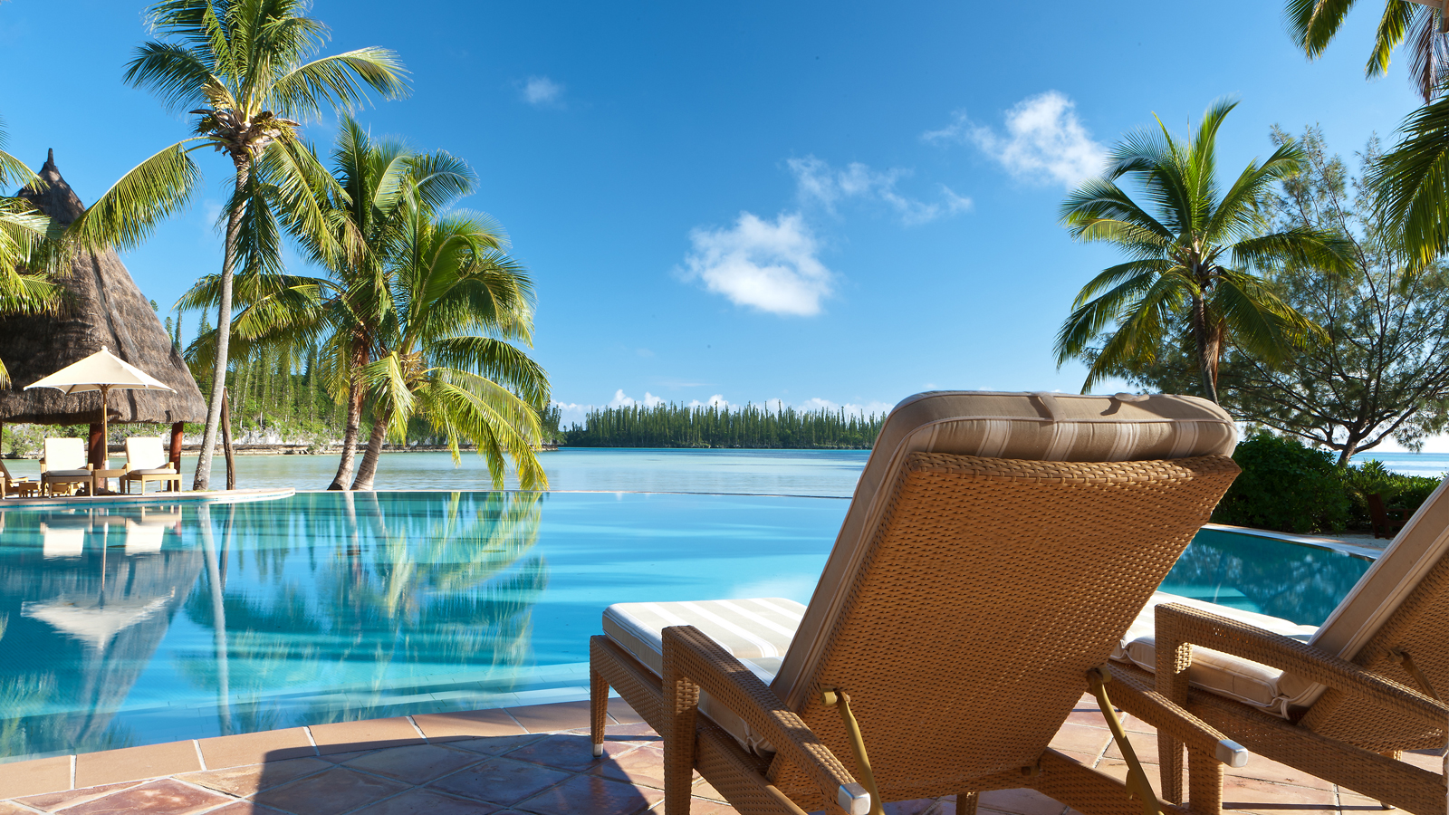 View across the infinity pool out to sea at The Méridien Hotel, New Caledonia.