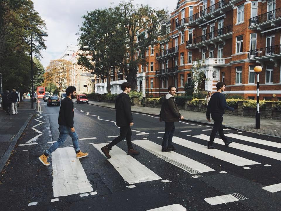 Four men on the Abbey Road pedestrian crossing, London