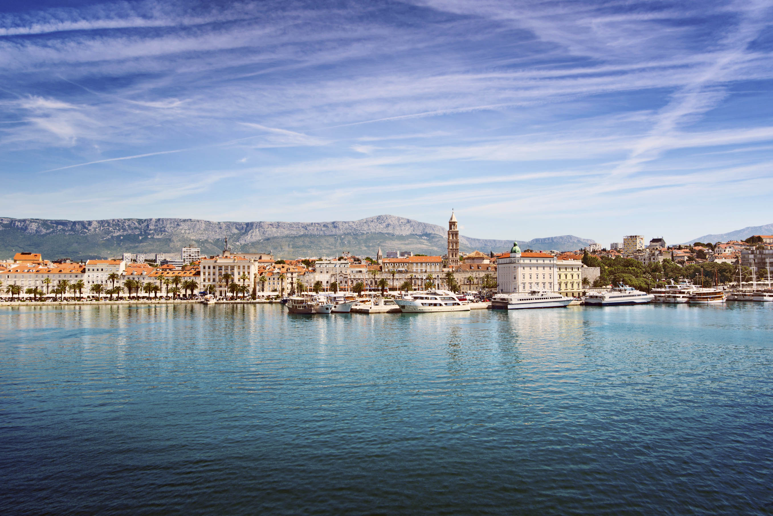 View from the calm sea towards Split and its boats and town buildings