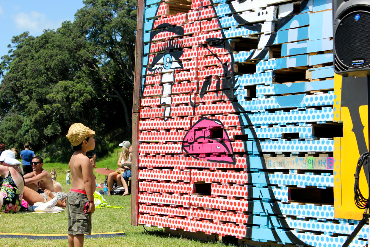 Kid admires a pop art sculpture