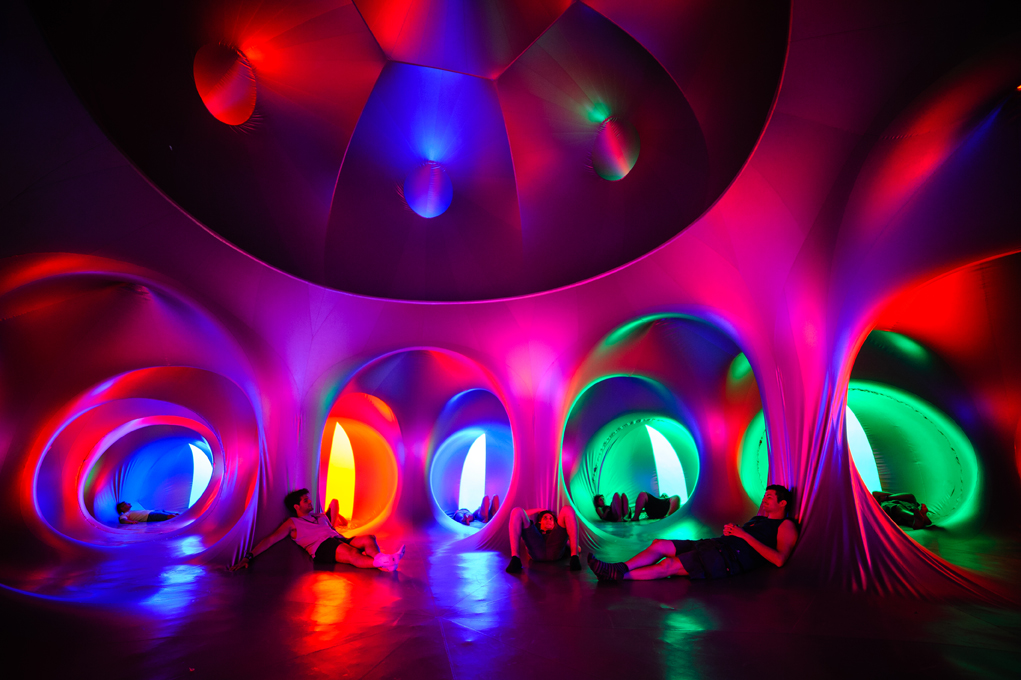People relax in a multicoloured dome