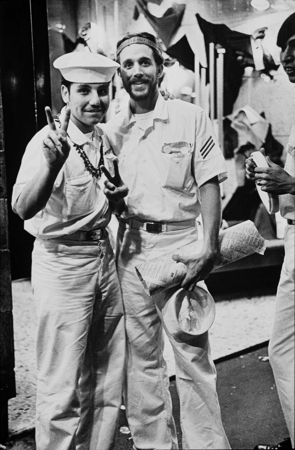 Two naval officers in Kings Cross circa 1970 in whites and making the peace sign. © Rennie Ellis Photographic Archive