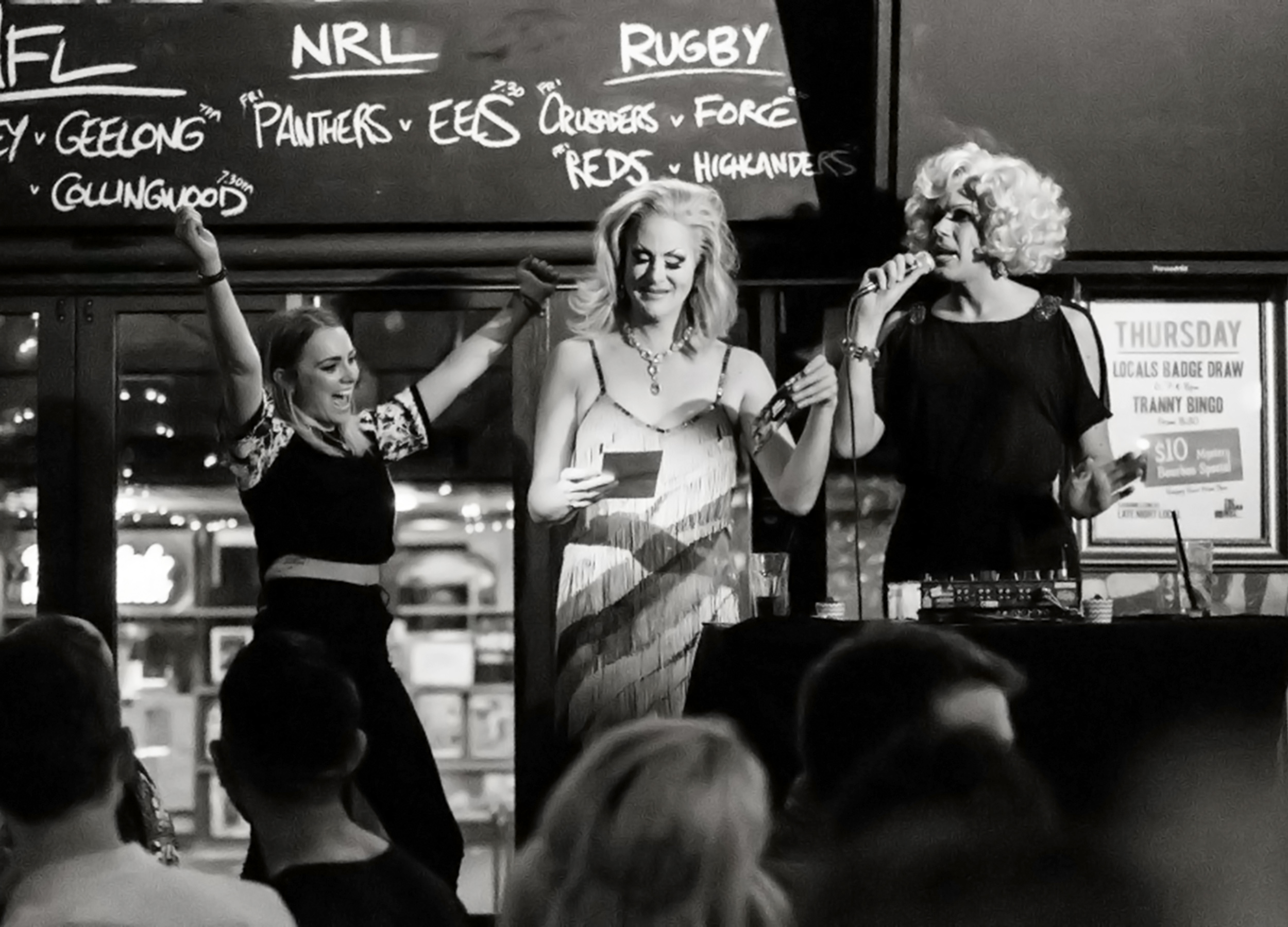 Drag queens on stage playing bingo at The Sugarmill Hotel in Kings Cross, Sydney