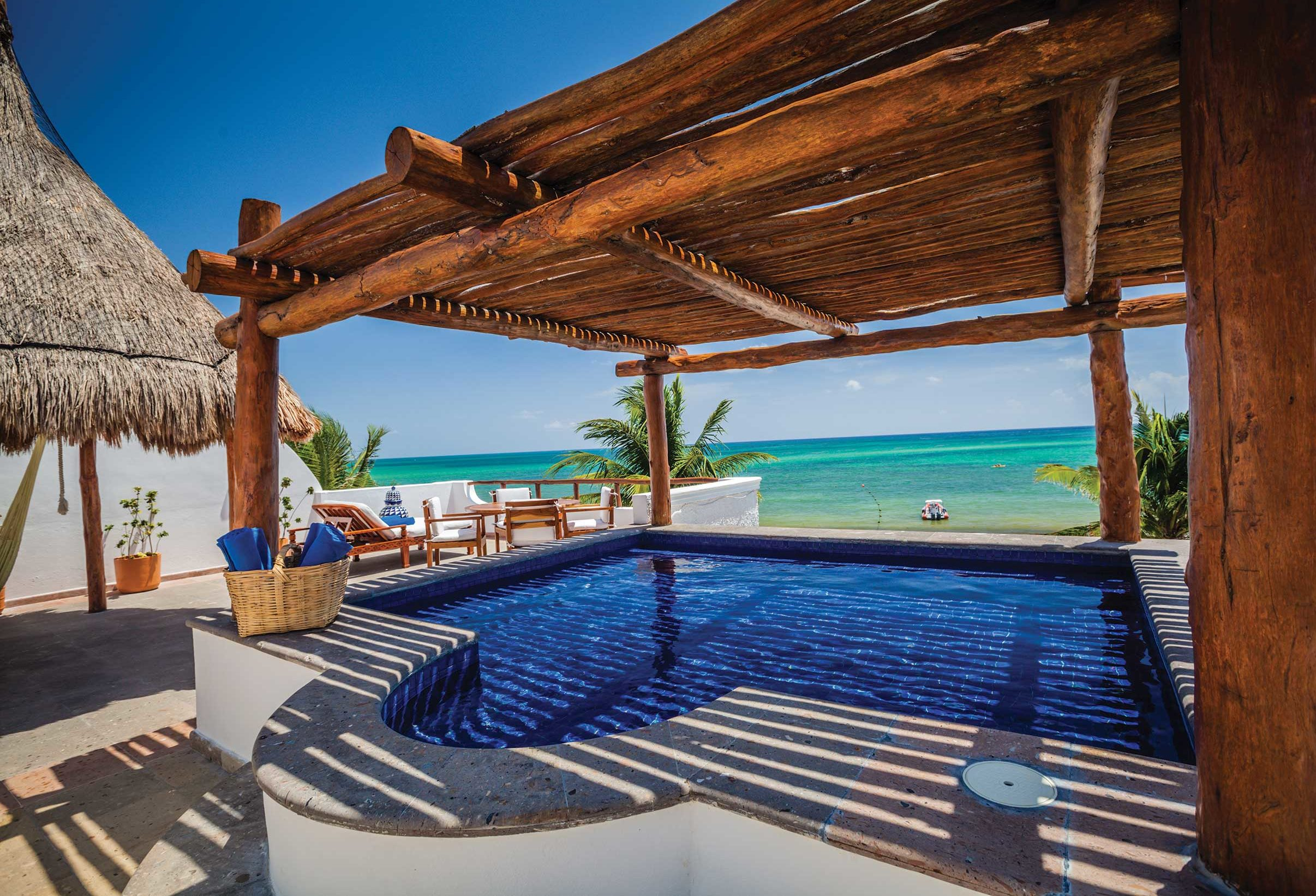 Wooden roofed rooftop plunge pool at Belmond Maroma, Yucatan
