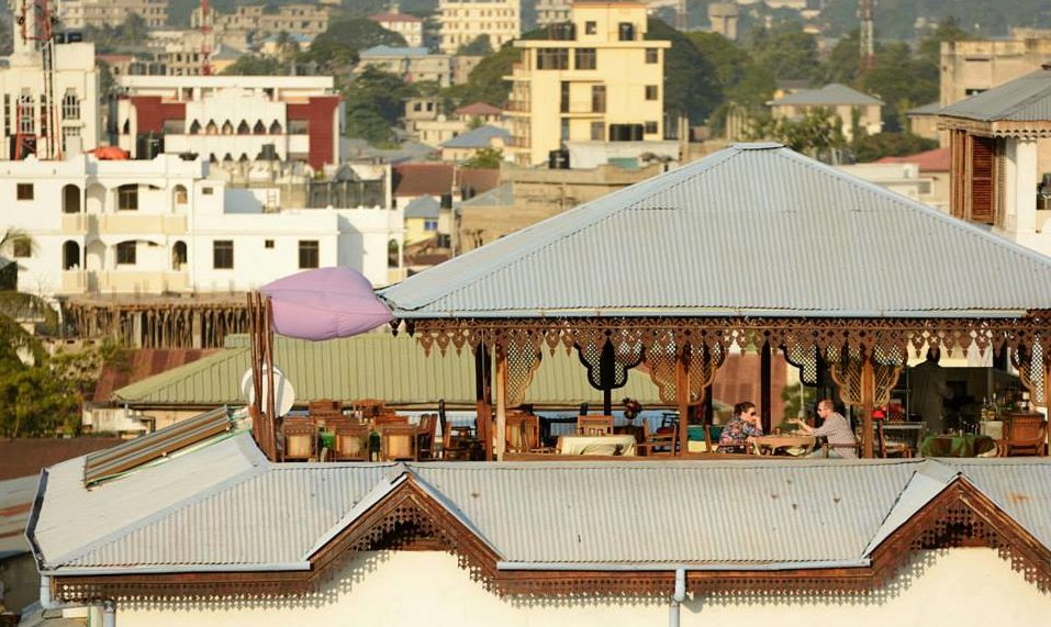 A rooftop view across to the Tea House restaurant at Emerson Spice and the city buildings beyond, Zanzibar City.