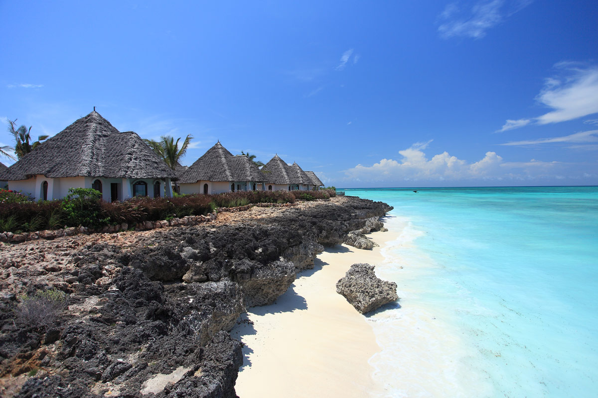 Oceanfront villas perched above the beach looking out to a very blue sea at Essque Zalu Zanzibar.