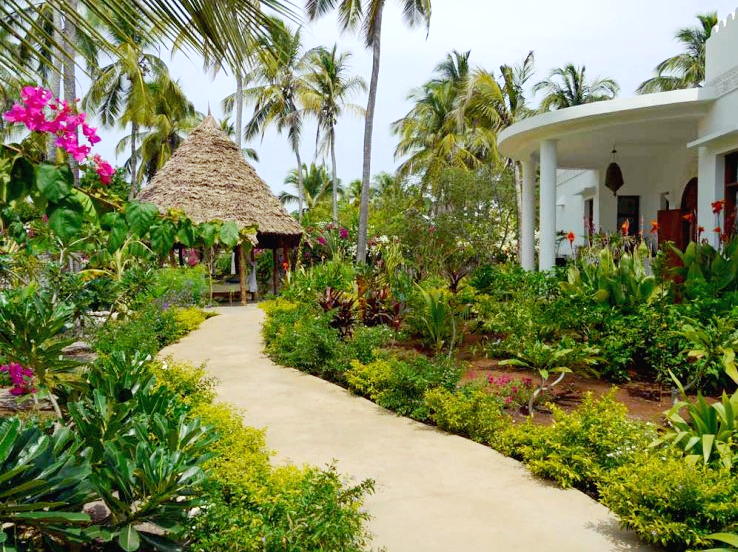 A garden pathway through wending through buildings at Boutique Hotel Matlai, Zanzibar.