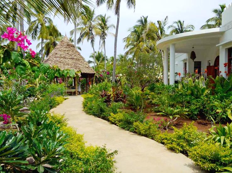 A garden pathway through wending through buildings at Boutique Hotel Matlai, Zanzibar.