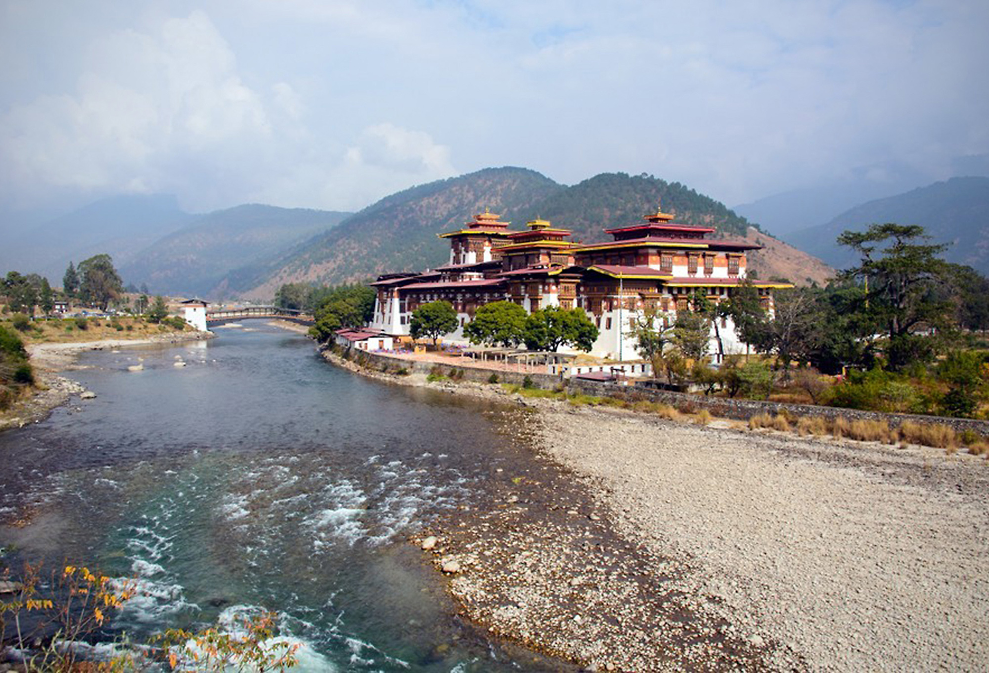 Beautiful ancient fortress palace, Punakha Dzong by a stony river, Bhutan