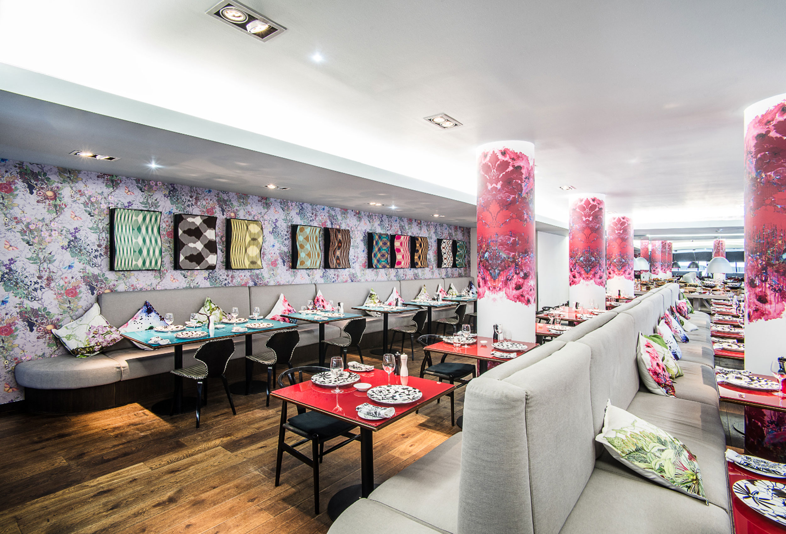 The very colourful tables, pillars and walls of Cucina restaurant, G&V Royal Mile Hotel, Edinburgh