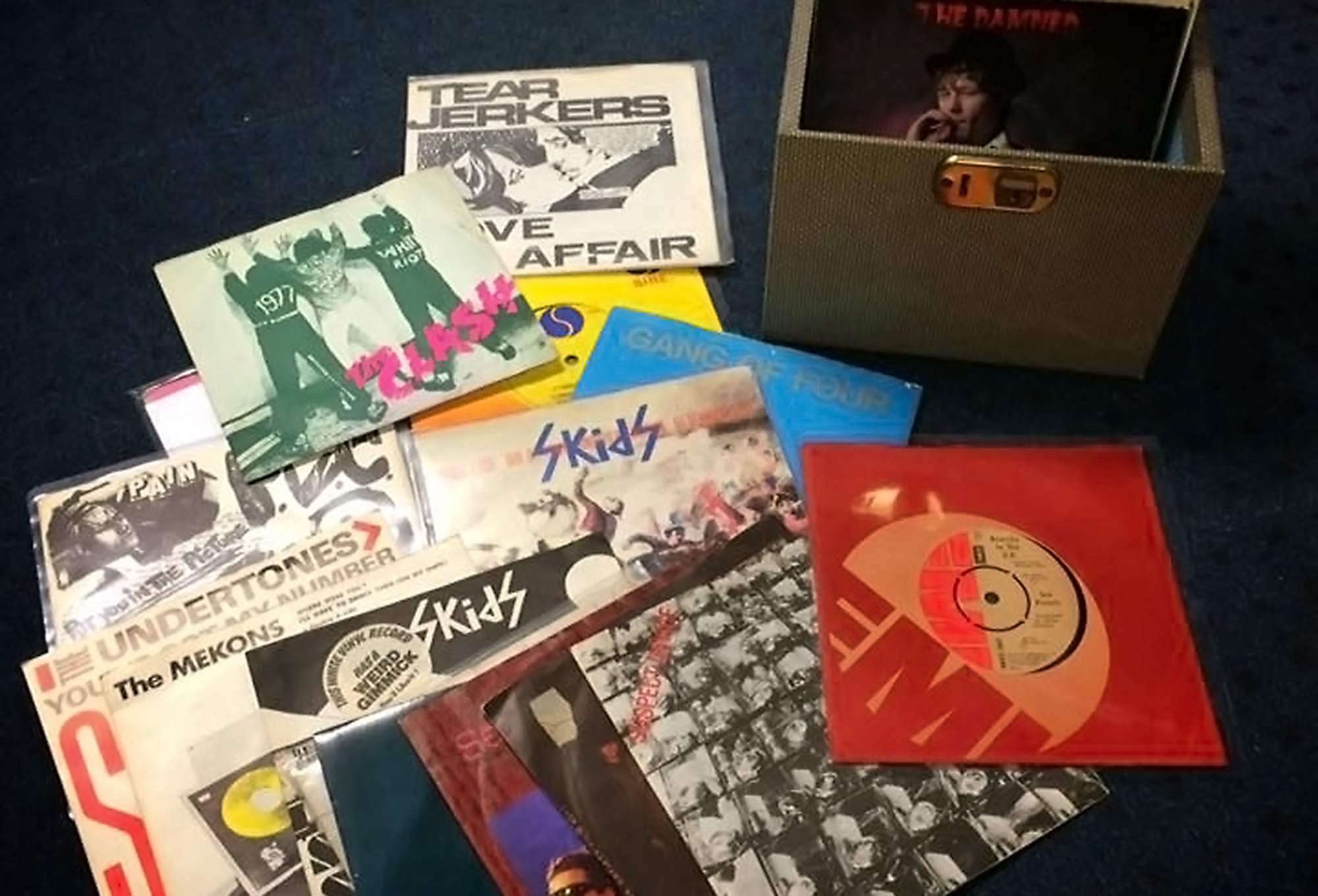 Image of rare records and CDs by a box at Image of rare records and CDs by a box at Unknown Pleasures, Edinburgh