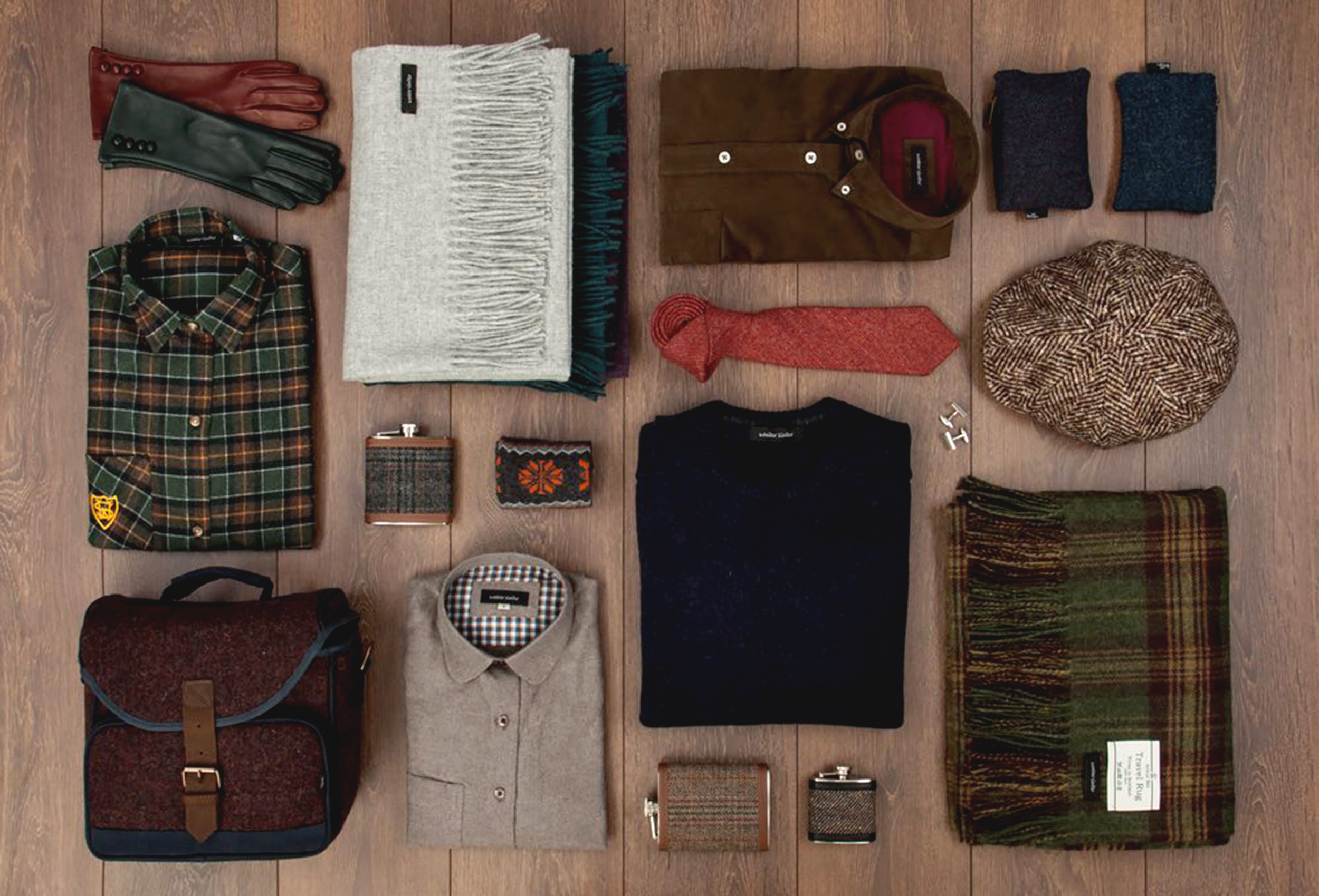 A collection of matched clothing and accessories displayed on a wooden floor at Walker Slater, Edinburgh