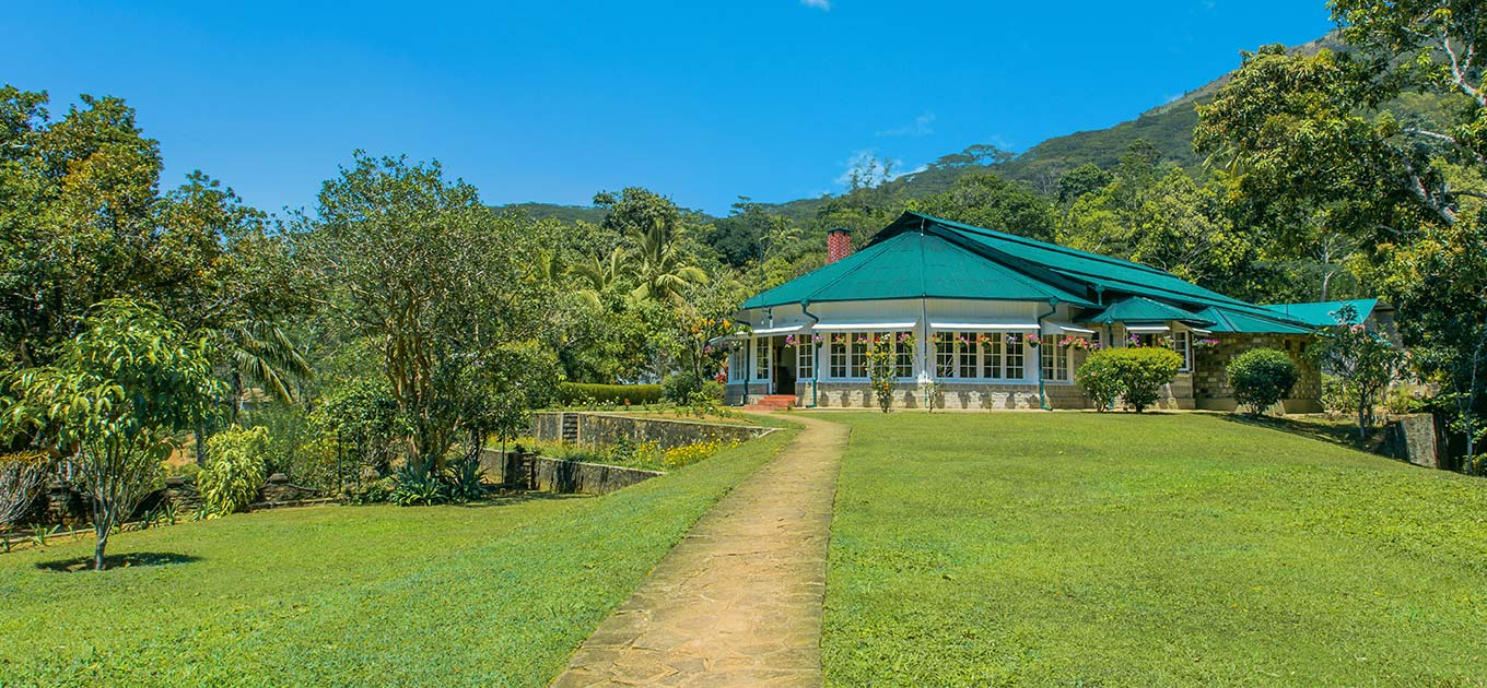 Expanse of green lawns leading up to the Mountbatten Bungalow, Kandy, Sri Lanka.