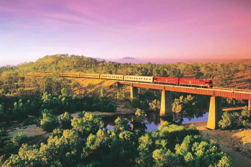 Train crossing a bridge over a river in Australia