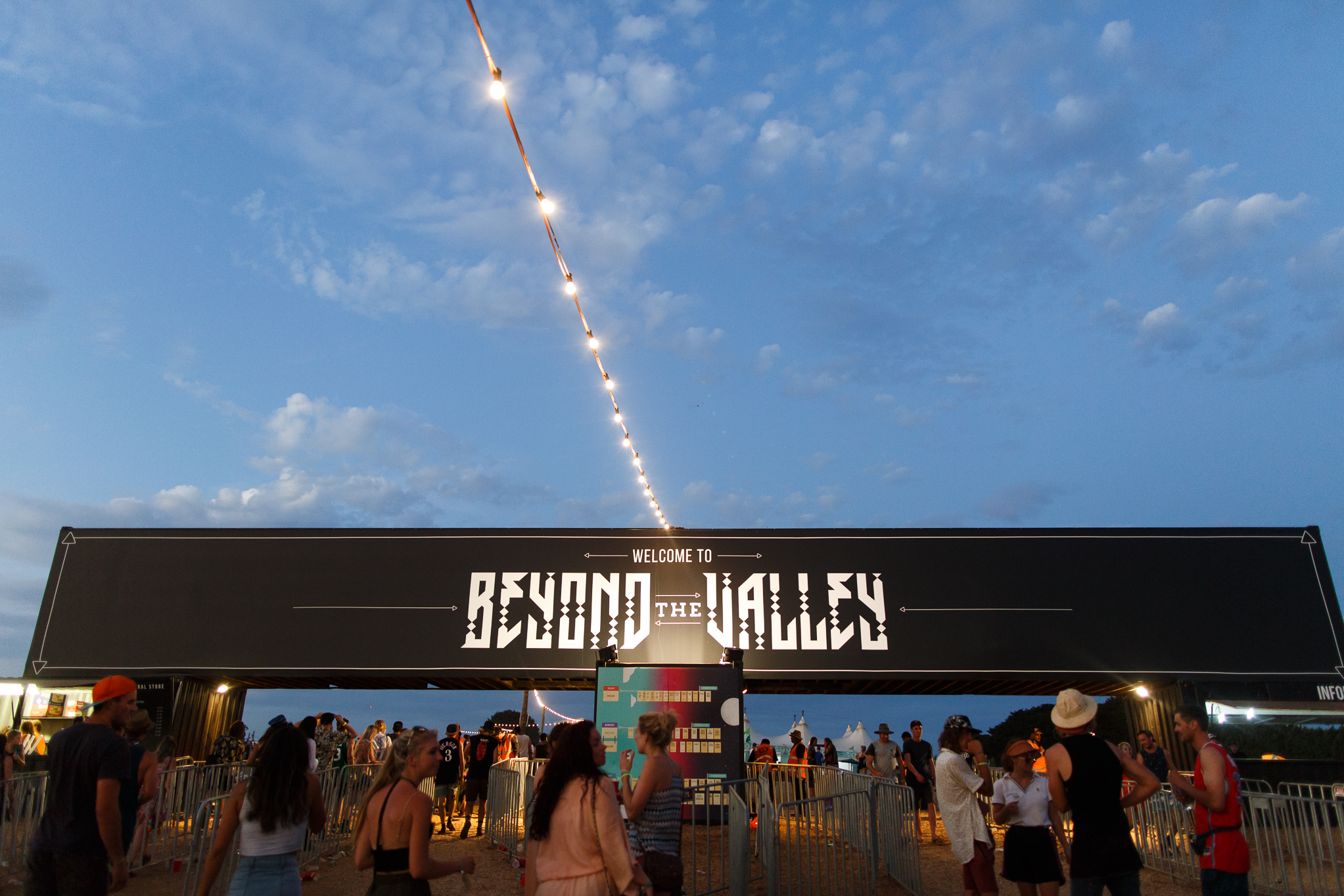 People standing below the entrance to Beyond the Valley Music Festival