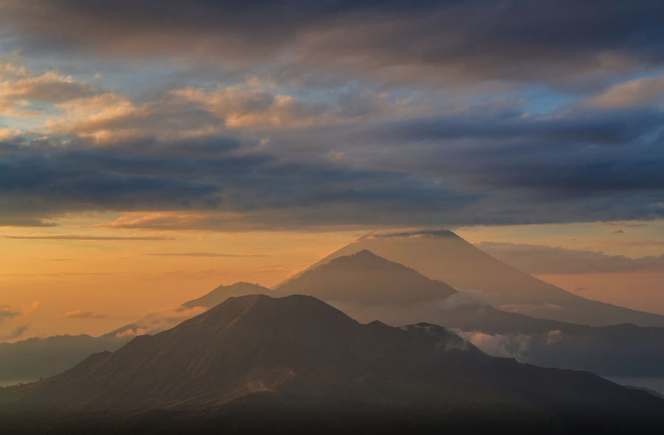 three volcanoes Batur, Agung and Mount Abang in a line at sunrise, Indonesia