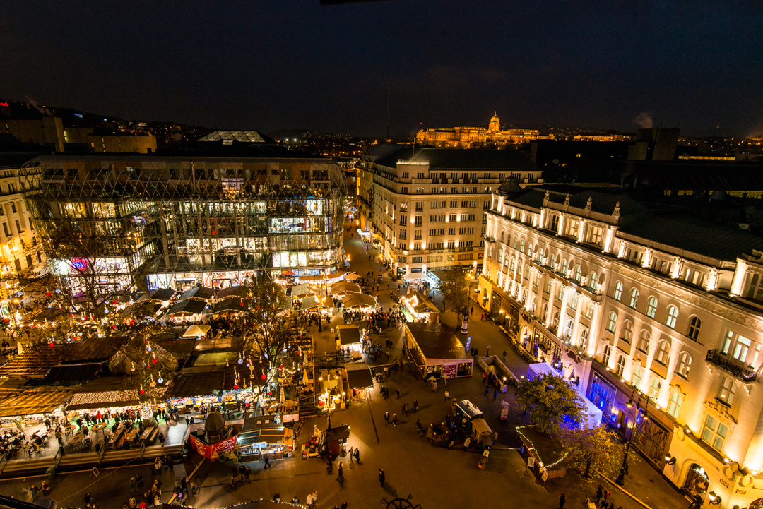 The town is lit up at night with Christmas lights