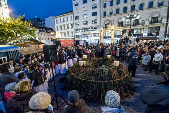 A choir gathers around to sing Christmas Carols at the Budapest Christmas Fair