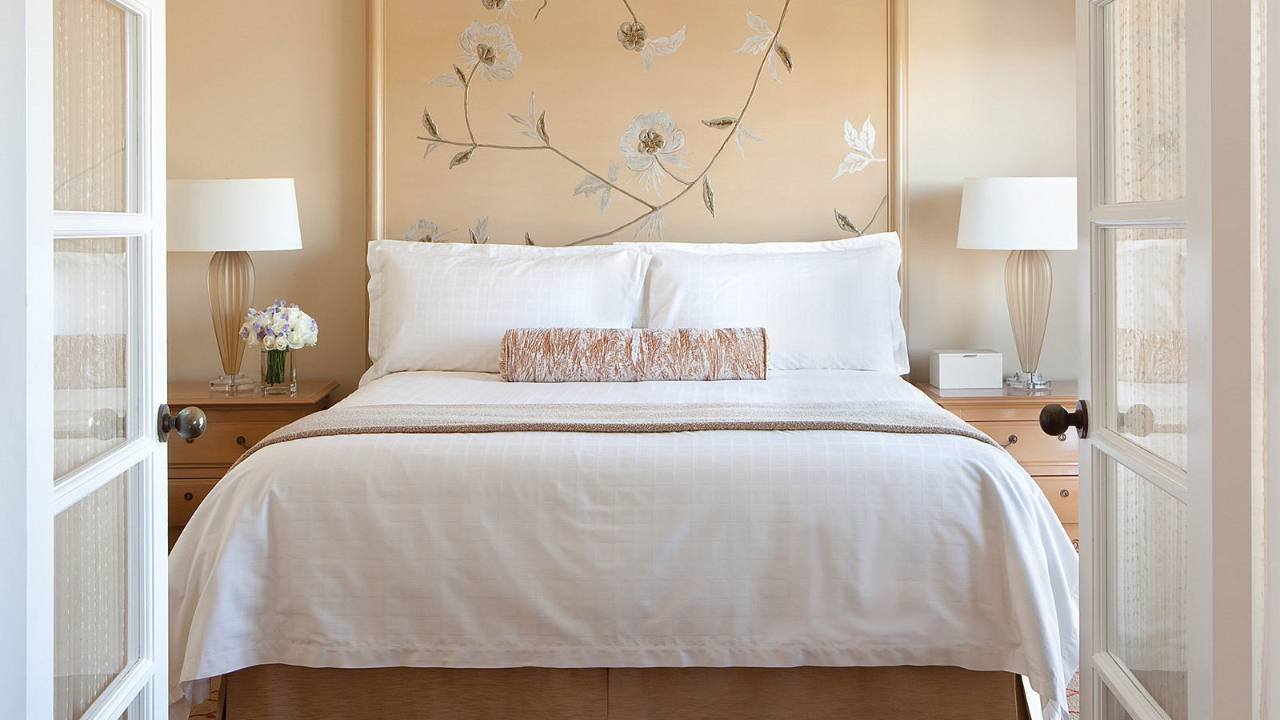 View onto a white-dressed queen sized bed at an Executive Suite at the Four Seasons LA