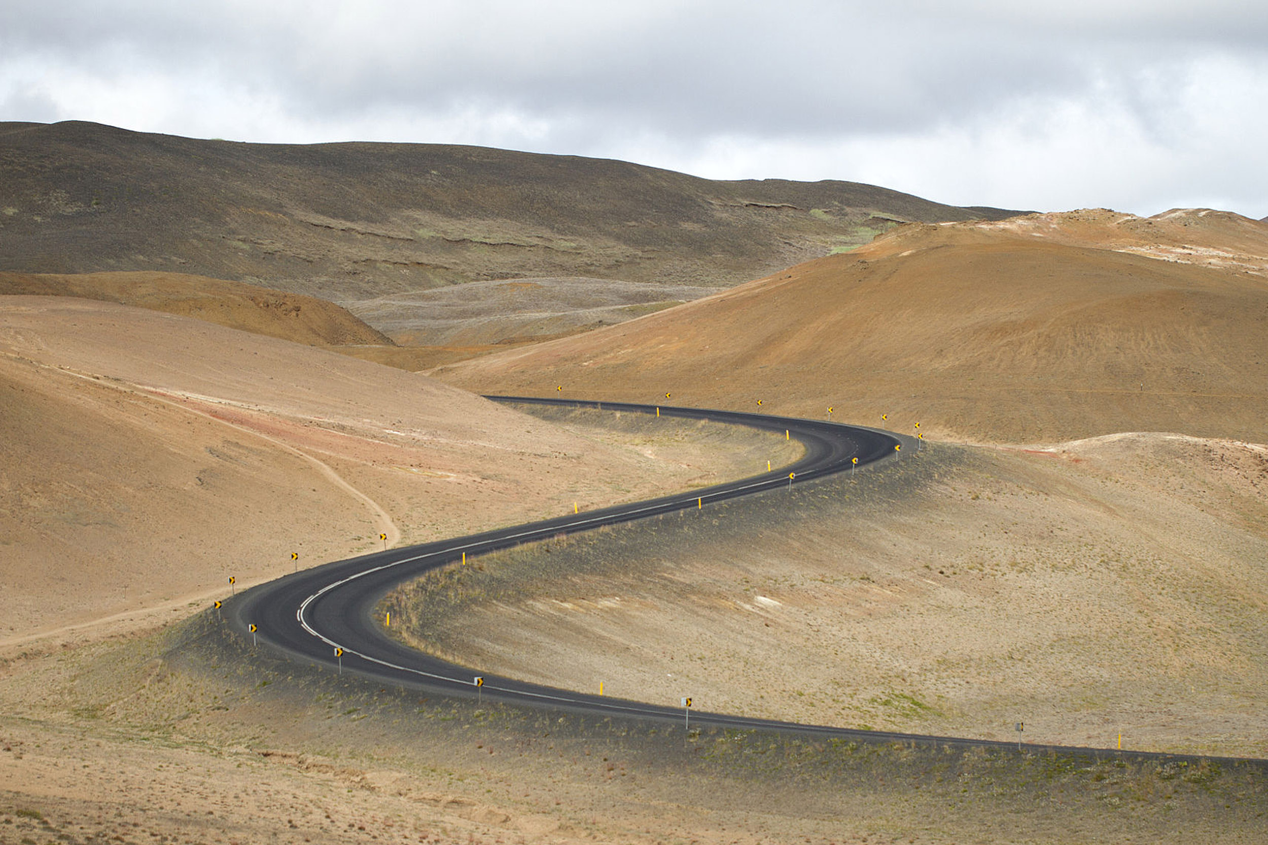 Iceland's coastal ring road navigates through volcanic terrain