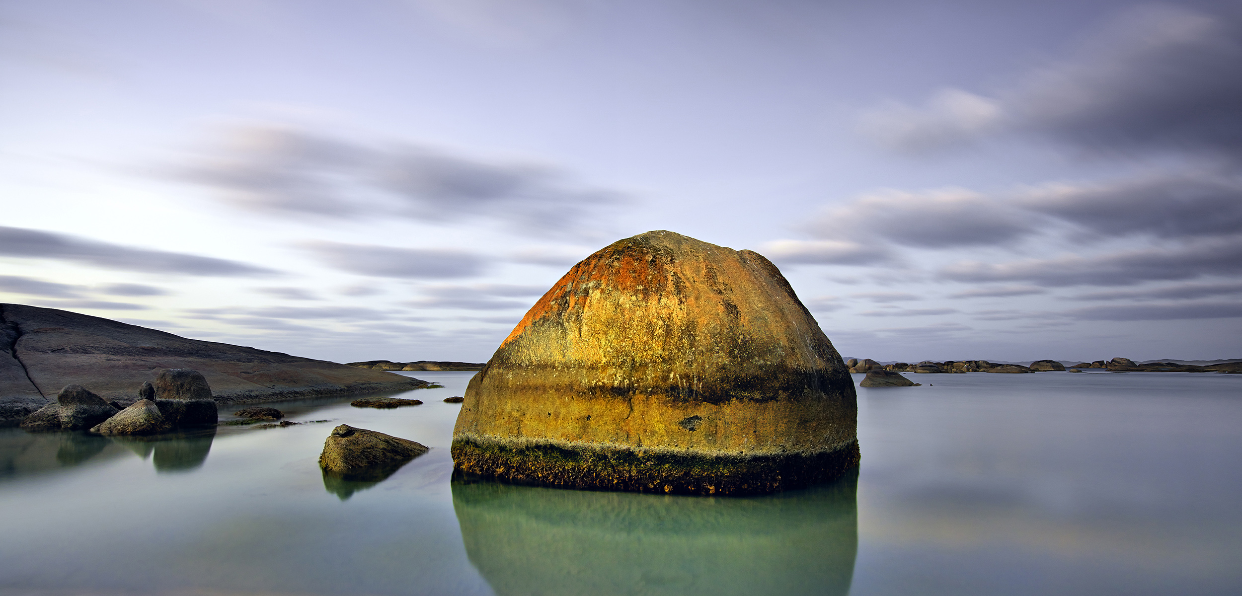 A rounded rock formation in the sea