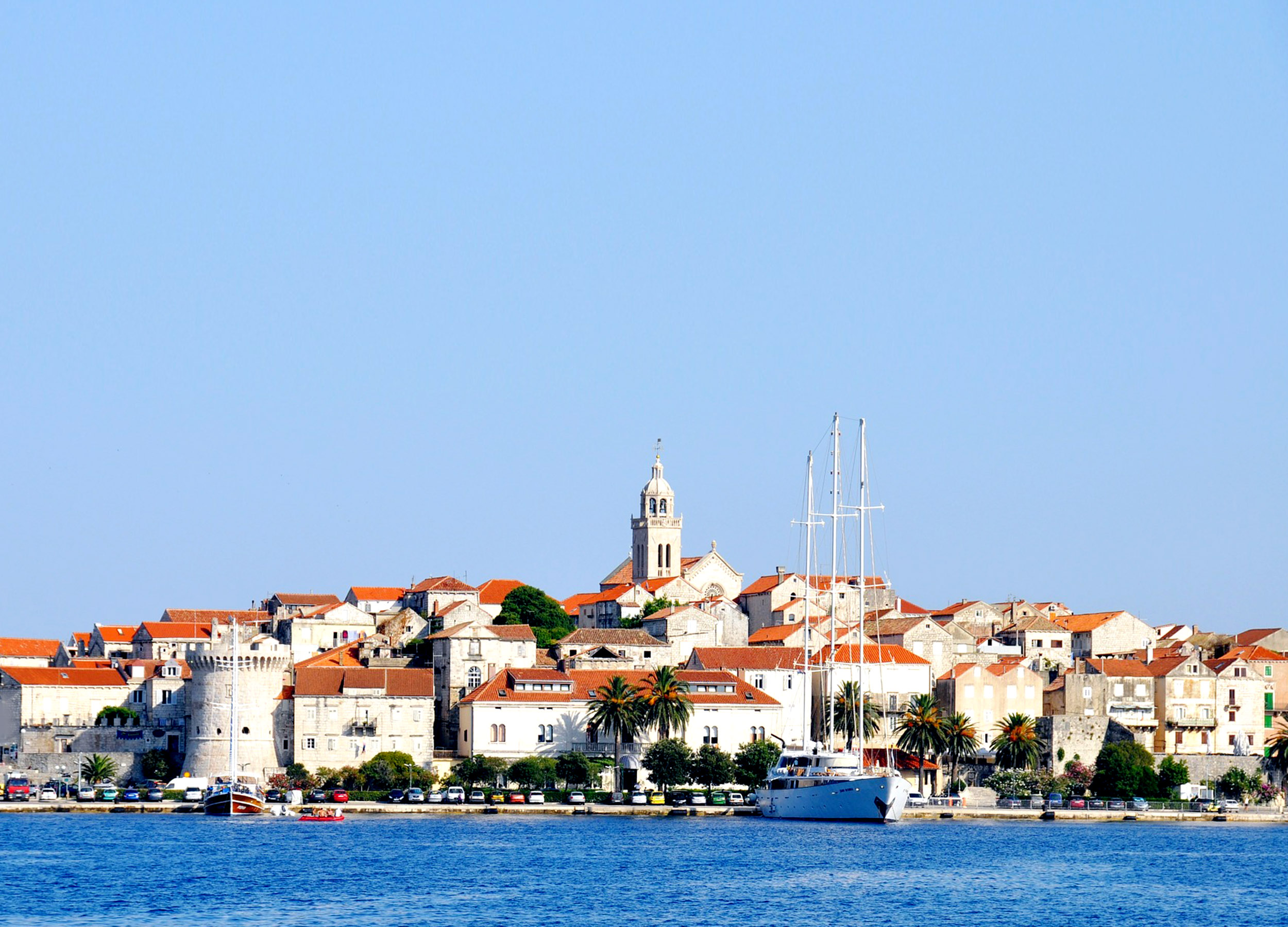 View from the sea of the red-roofed white buildings of Korcula in Croatia