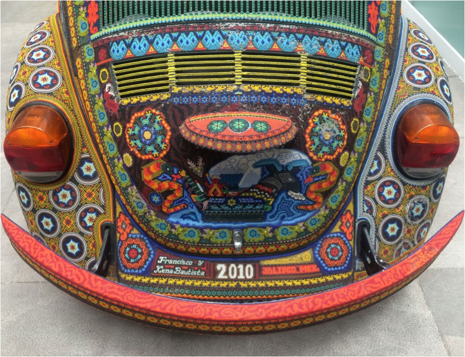 Rear shot of a multicoloured bead-patterned Volkswagon