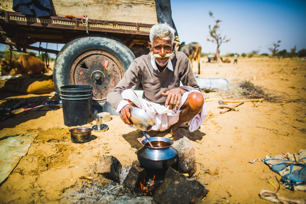 A camel salesman on the busy highway between Jodhpur city and the desert sands of Dechu, Rajasthan.