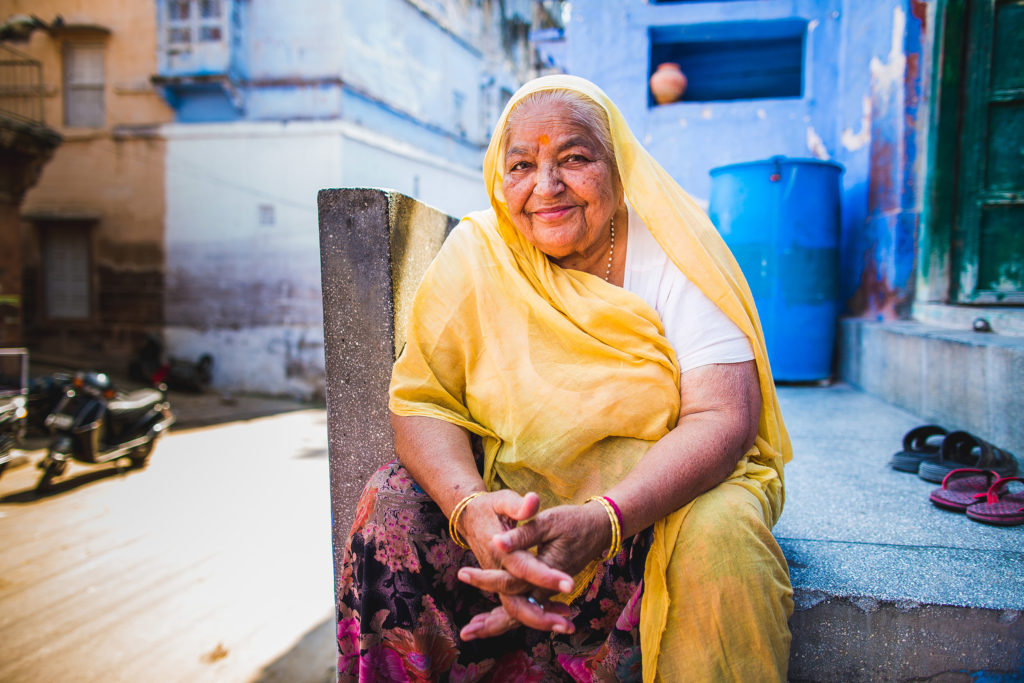 A woman smiles in Jodhpur's old neighbourhood, the so-called 'Blue City' surrounding the Mehrangarh Fort that towers over the city.