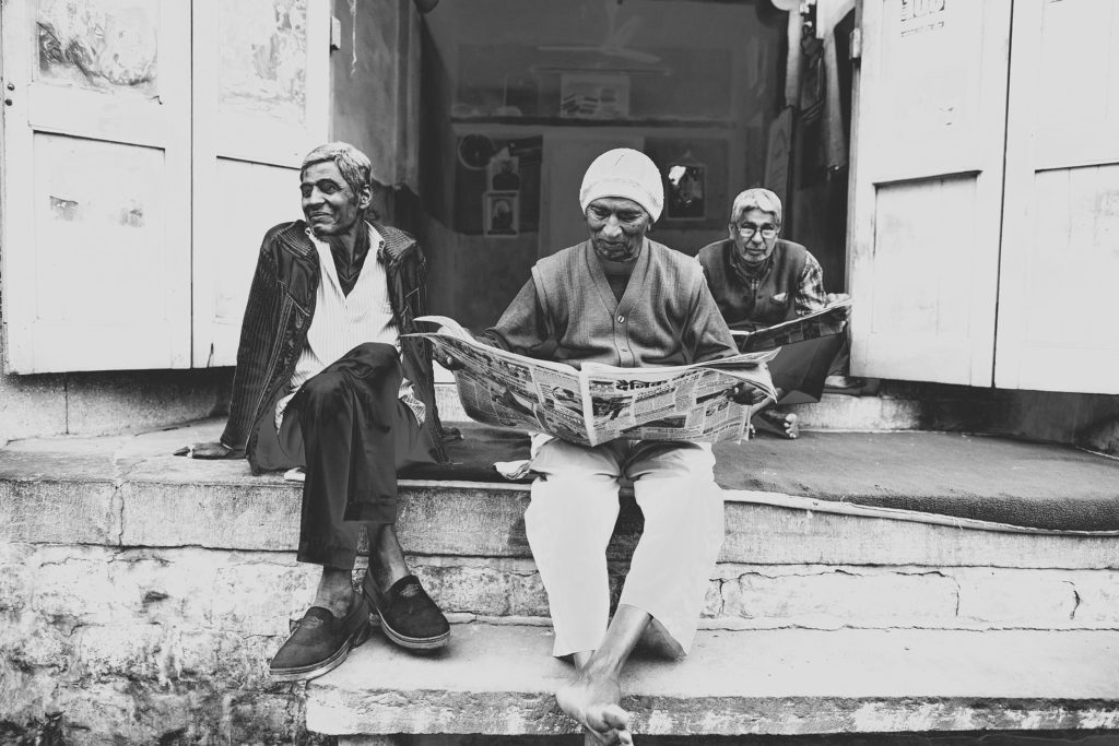 Three men relaxing, a typical scene in the winding streets of old Jodhpur.