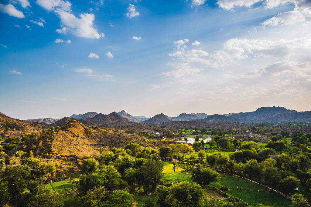 A verdant valley near Udaipur in Rajasthan stretches as far as the eye can see.