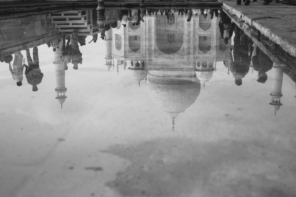 The reflection of the Taj Mahal in one of the many pools that line the main section of the complex.