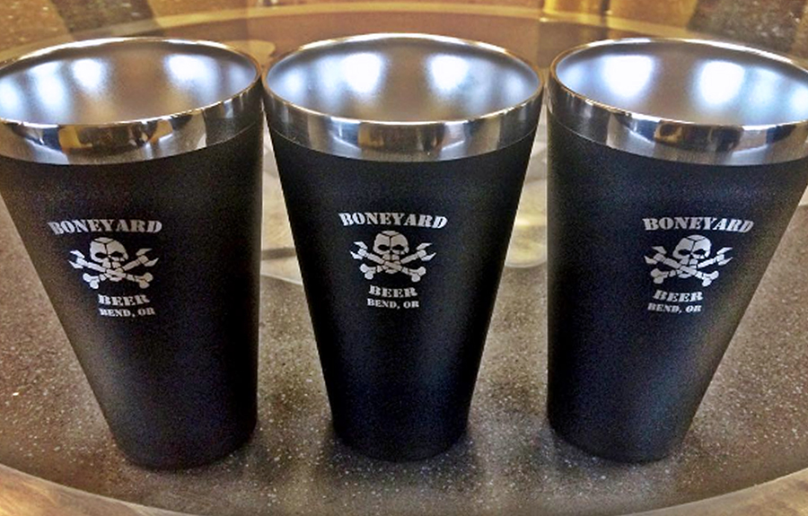 Three monogrammed tumblers of Boneyard Beer on a table