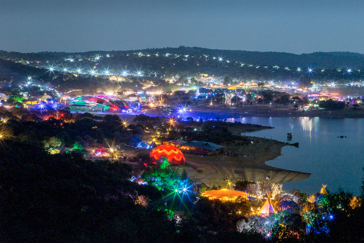 Aerial view of the bright lights of Boomland and Idanha-A-Nova Lake